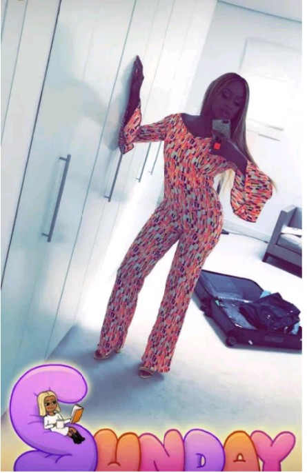 PHOTOS: Billionaire's Daughter, DJ Cuppy Poses In Jumpsuit Beside Her Bullet Proof G-Wagon