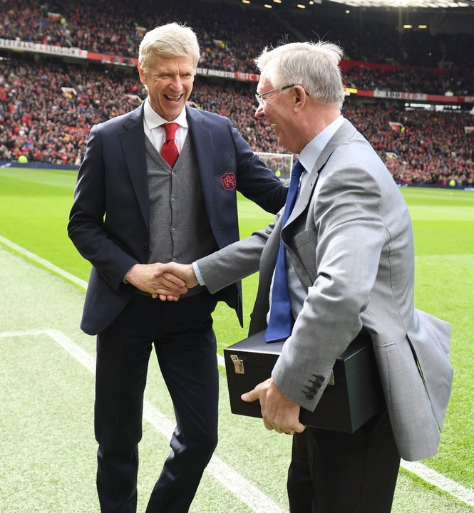 Arsene Wenger Presented With A Priceless Vase At Old Trafford