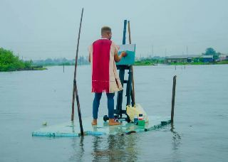 Picture Of A YABATECH Student Drawing On Water Goes Viral (pictures)