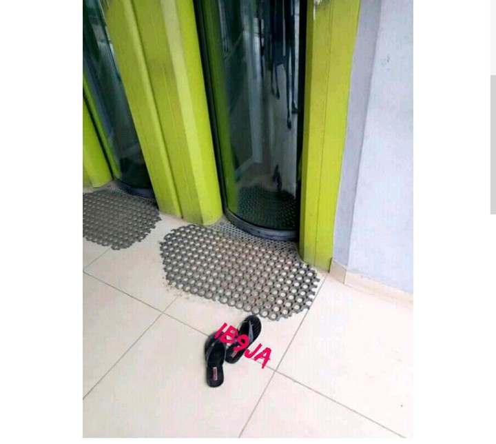 LORD !!!:  Lady Removes Her Slippers Before Entering A Bank In Abia State (Photo)