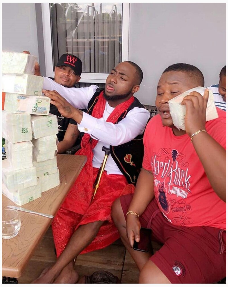 PHOTOS !!!:  Davido Stacked Up Wards Of Cash To Be Sprayed At A Wedding In Owerri (Pics)