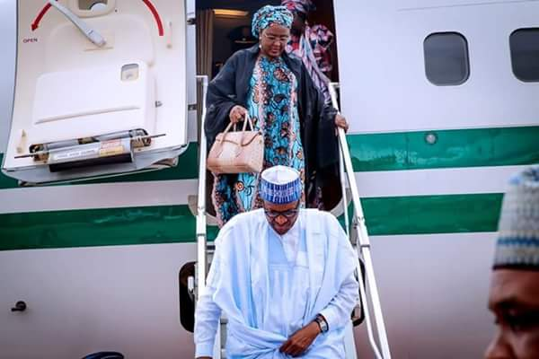 PHOTOS !!!:  President Buhari Pictured With His Wife, Aisha, At The Airport