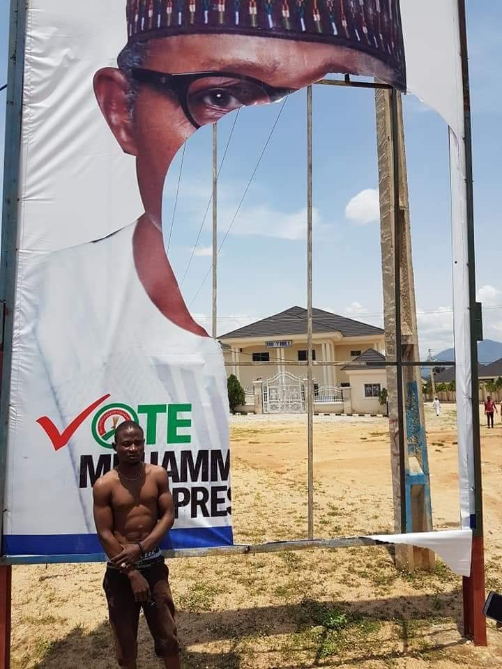 Image result for Man Arrested After He Was Caught Destroying Buhari's Campaign Posters.