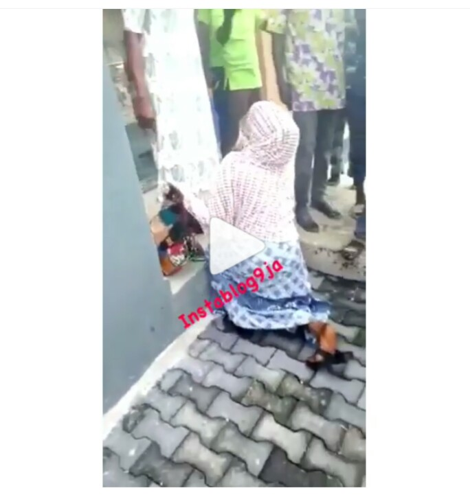 Image result for Woman Really Begging For Her Life After She Was Caught Stealing Stockfish in Lagos.