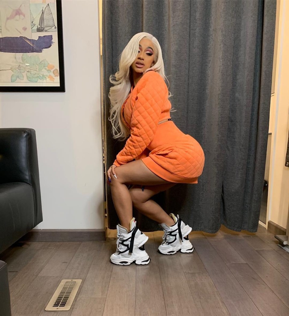 Tongue Cardi Bs: Cardi B's Double Sneakers Has Tongues Wagging (see Photos