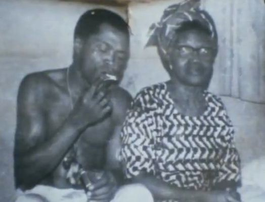 Burna Boy Smokes In Front Of His Mother As She Welcomes Him
