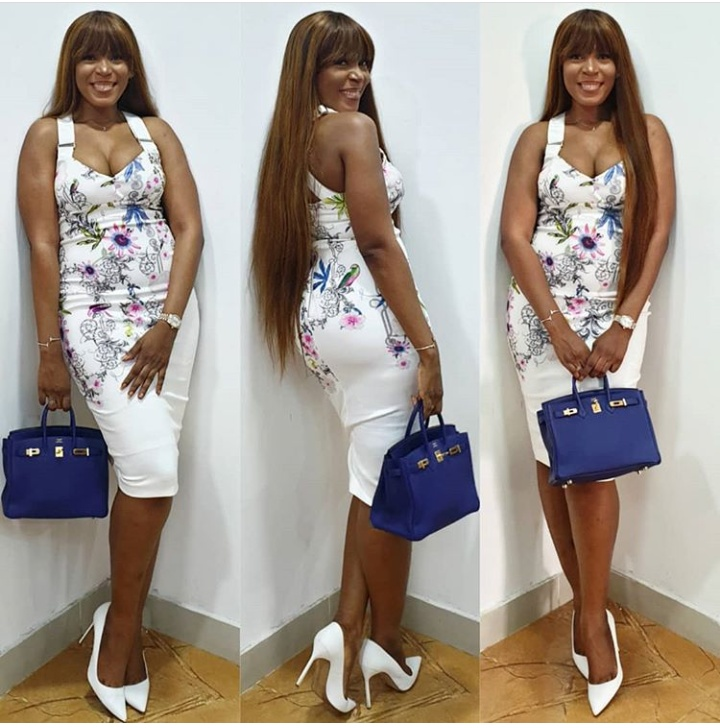 Image result for Linda Ikeji Stuns In Cleavage-baring Body Fitting Dress
