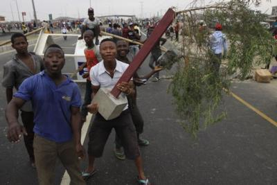 Image result for Angry Crowd Destroy Police Post, Smash Vehicles In Abuja