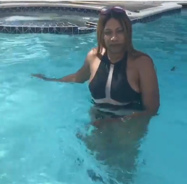 Ex-beauty Queen, Regina Askia And Husband Kiss Inside Swimming Pool