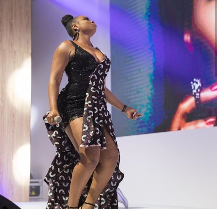 Yemi Alade Bares Cleavage In Sultry Outfit